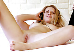 Adorable slender cutie with incredible tits spreading legs on the bed in this xxx video.