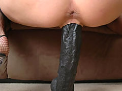 Sexy Blonde Rides A Huge Black Dildo